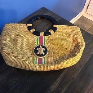 Braciano straw purse with turtle charm